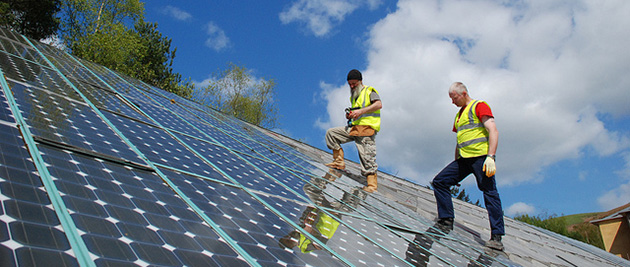 Major utilities feel threatened by the spread of solar energy and are fighting back by charging homeowners for selling surplus electricity into the grid. (Photo credit: Centre for Alternative Technology, flickr)