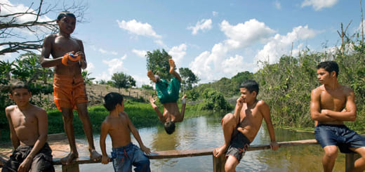 Young residents of the National Tapajos forest swim in the river to cool-off from the intense heat of the Brazilian sun.